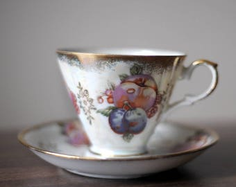Japan porcelain tea cup with fruits motives