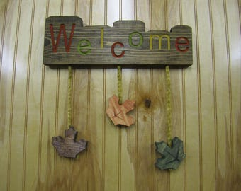 Welcome with hanging leaves
