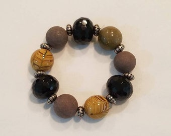 Black crystal beaded bracelet, brown and amber colored glass beads , stretch