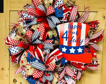 Fourth Of July deco mesh wreath, red, whit, blue ribbon. Will look beautiful on any front door.
