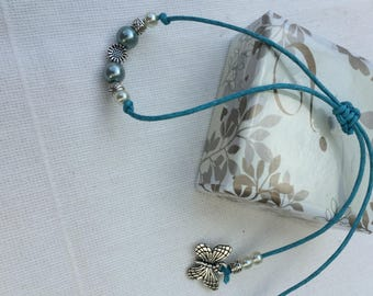 Butterfly charmed vintage woman's adjustable bracelet made with good quality Tibetan beads