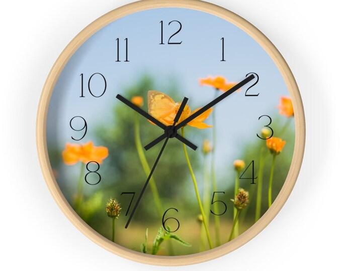 Orange Poppy In Field of Green With Blue Sky Flower Wall Clock