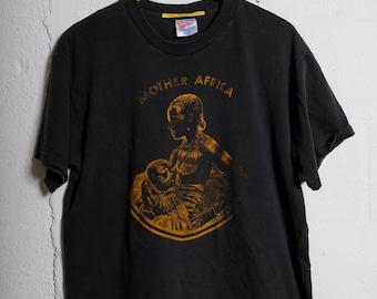 5d0d4d577 Vintage 90's Mother Africa T Shirt Thrashed! Soft! L 1026