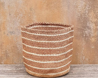 "TENA: 9""W x 10""H Earthy toned sisal basket"