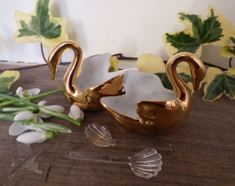 Pair of small gold coloured swan shaped Limoges ceramic salt pots with spoons