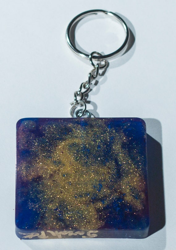 A fun coulorful high heel resin shoe keychain Functional Art that can be taken with you.