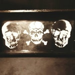 Black and white tray with hand painted skulls