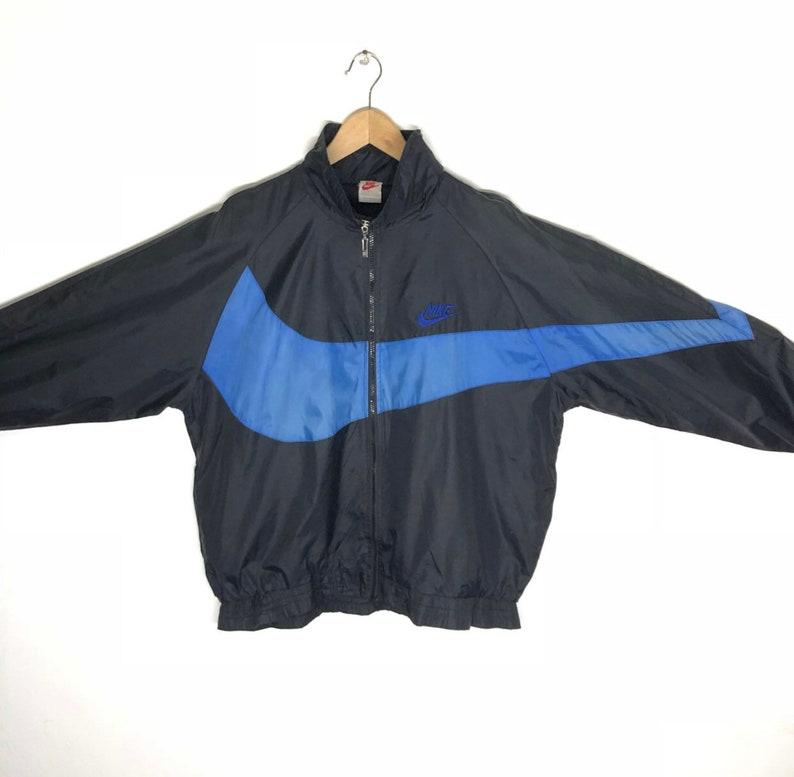 530e68eea09595 RARE Vintage 90s Nike Big Swoosh Logo windbreaker jacket