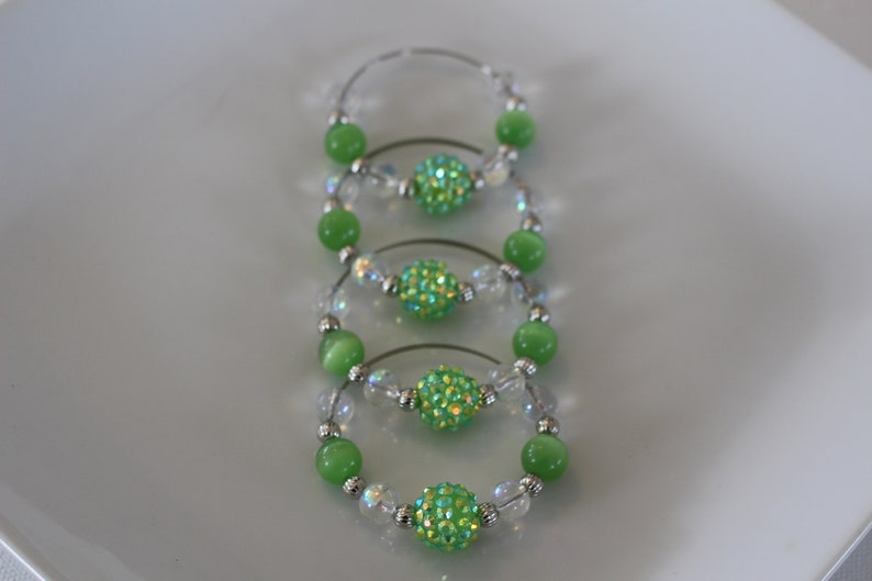 Clear and silver beads add to the look of these fun napkin rings Set of 4. Fun green glass bead napkin rings