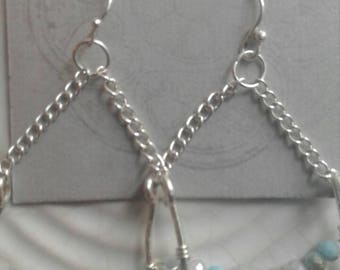 These are amazing..hammered silver wire in u shape design with chain and sterling hooks...