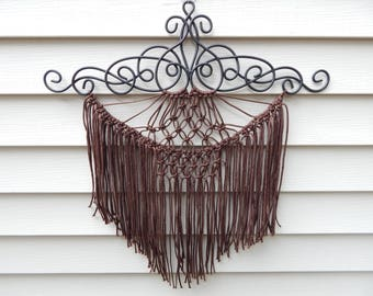 Lacy ironwork with dark brown cord