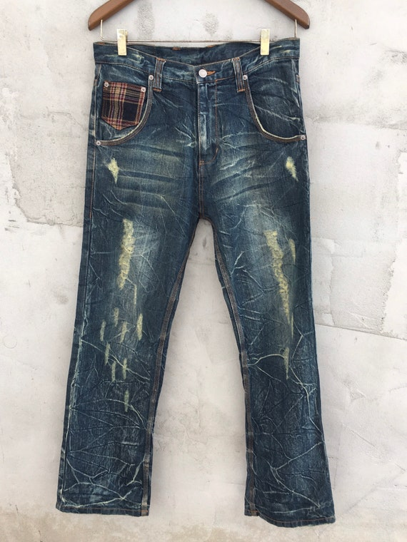 Asna Dispect Ripped Patch Jeans