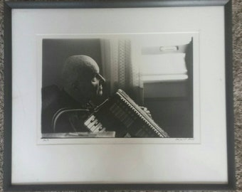Professionally framed and matted 8 x 10 original photograph signed by the photographer