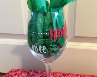 Naughty or nice hand painted wine glass
