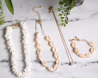 Set of 4, Puka Shell Necklace, Cowrie Shell Necklace, Gold Pearl Necklace, and Cowrie Shell Bracelet