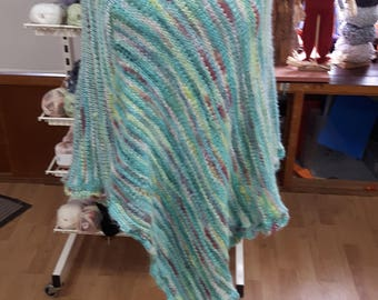 Knitted poncho.