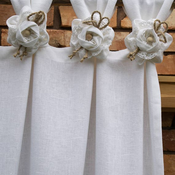 White linen curtain with handmade flowers.