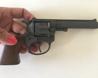 Vintage toy. Toy gun. Revolver for children.