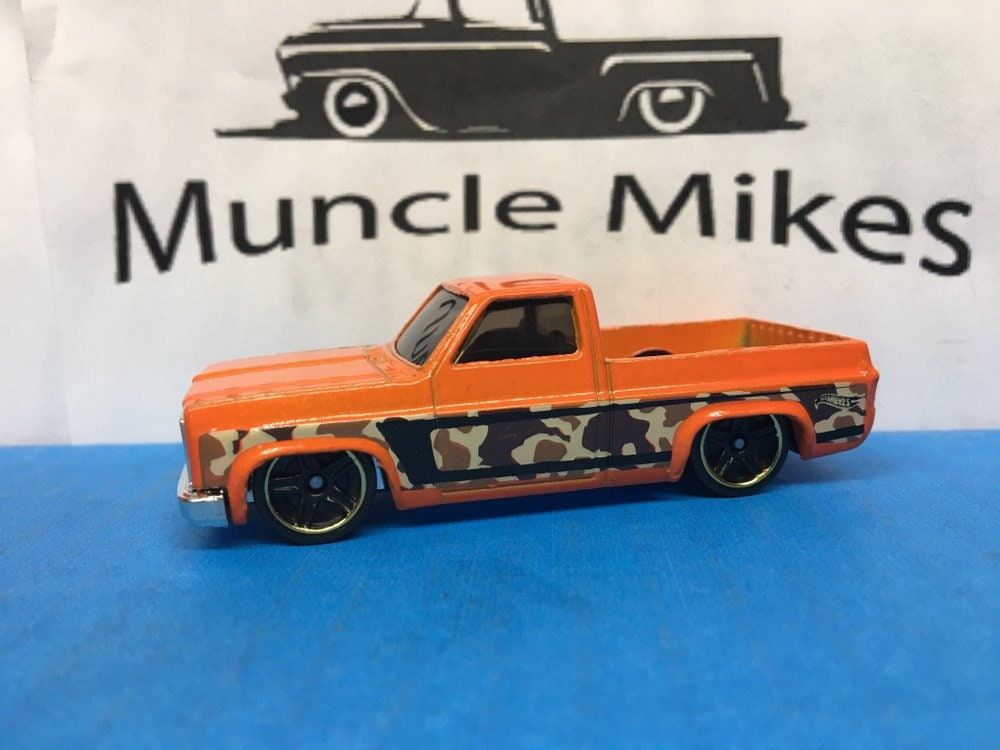 Collectible 2018 Hot Wheels 1983 Chevy Silverado Pick Up Truck Orange Camouflage With Custom Clear Display Case