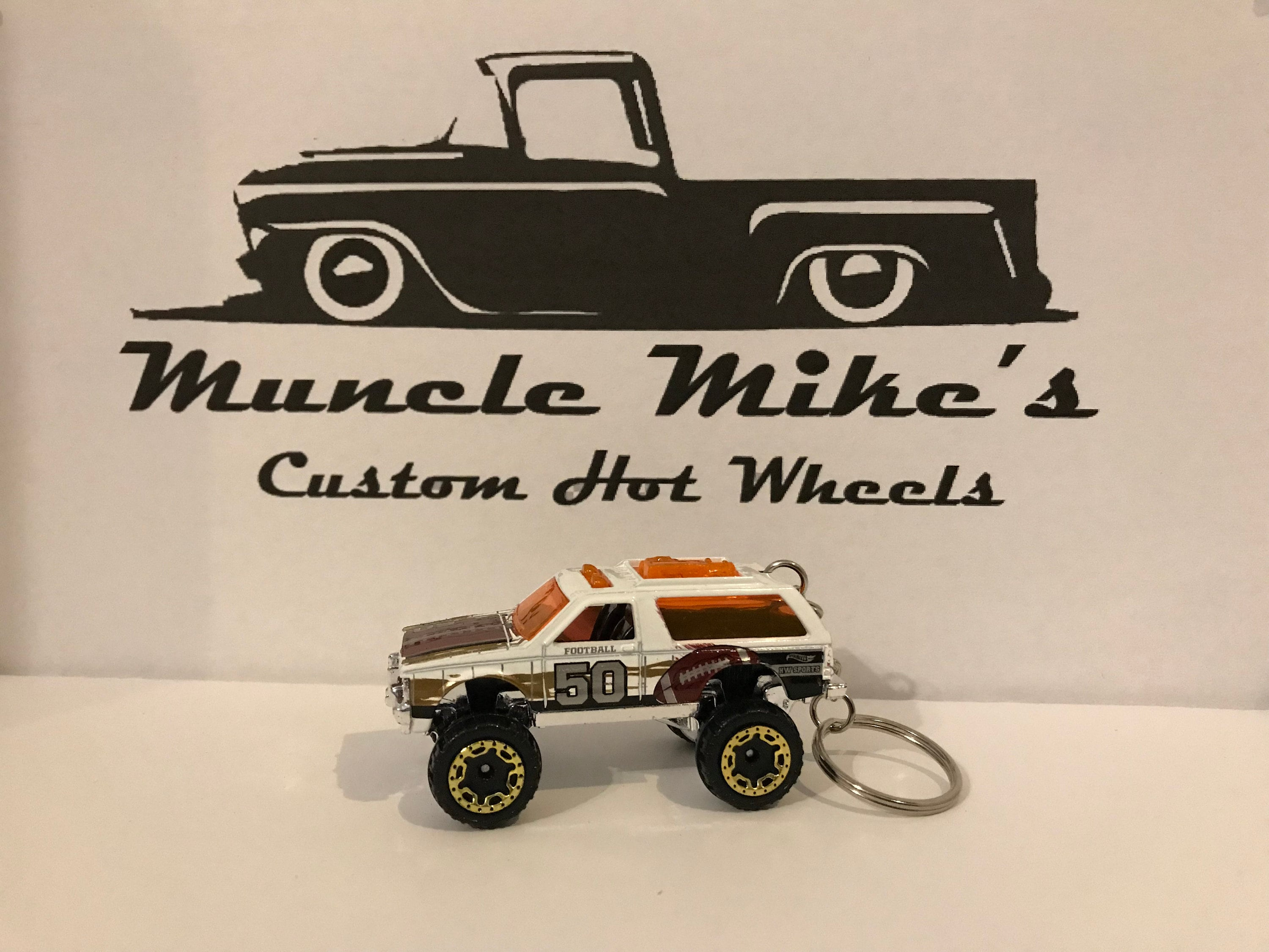 Custom Hot Wheels white Chevy Blazer 4x4 with football graphics Christmas Ornament,  Keychain or Zipper Pull
