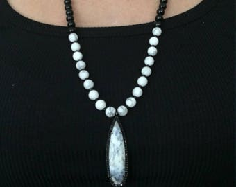 White matte marbled beaded necklace with pendant surrounded by black CZ
