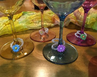 Wine glass charms, Set of 4 different spring flowers on memory wire with clear glass beads.