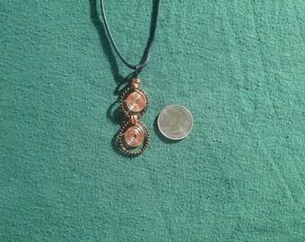 Metal spiral pendant.