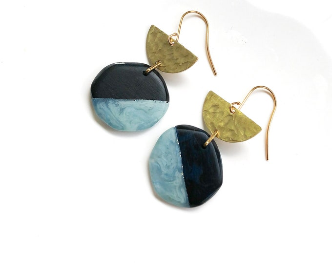 Resin earrings: contemporary handmade originals. Deep blue and light blue contrast with textured brass semi circle detail