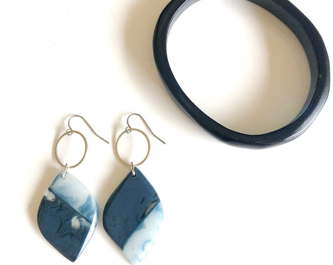 Resin earrings and bracelet: hand sculpted combination of deep blue and light blue resin, the bangle is medium size with marbling