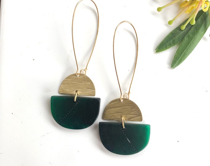 Resin earrings: contemporary design, deep greens with brass half moons, long dangles