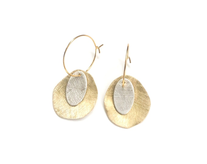 Brass and silver hoop earrings: handmade organic shaped brushed brass earrings with etched silver disc