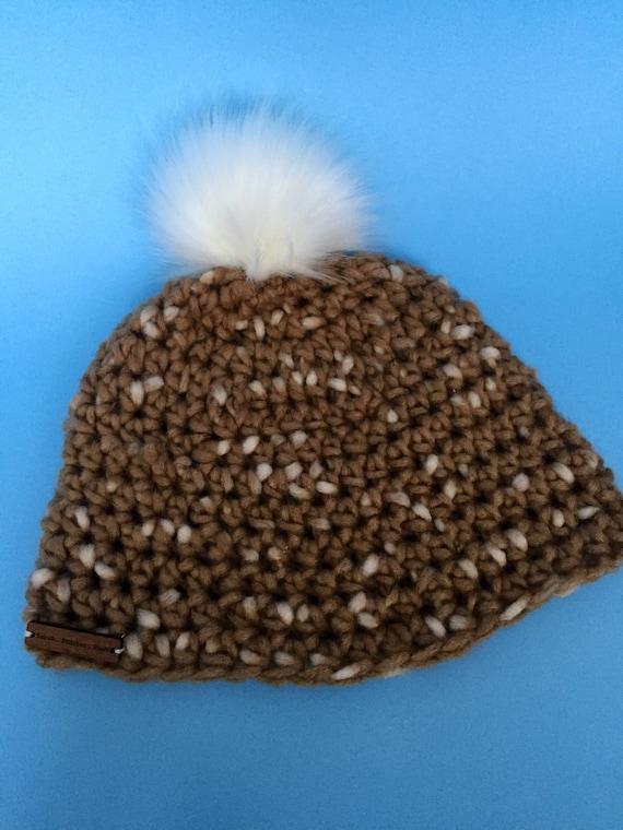 e64f5375c8286 Brown and white pom pom beanie hat