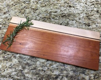 Cherry, maple, and purple heart cutting board