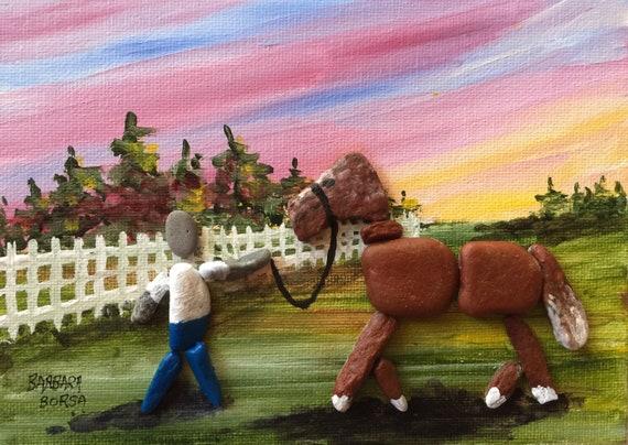 Walking a horse in pebble art