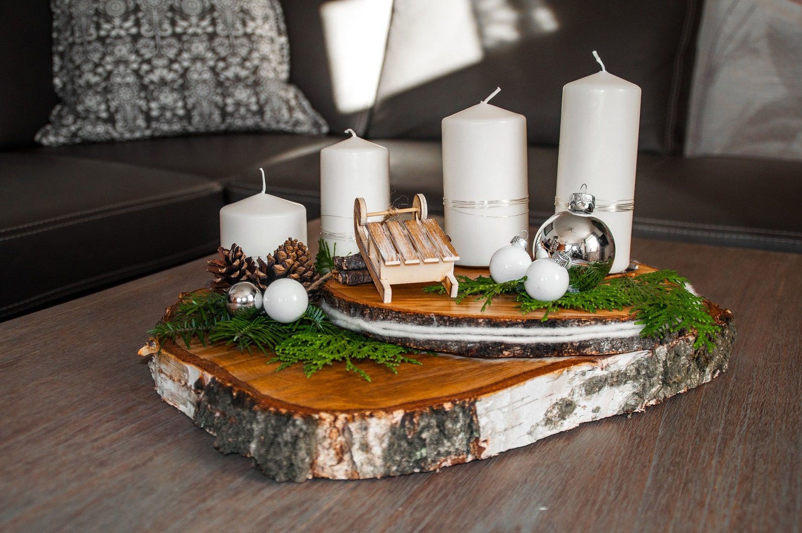 Beautiful Advent wreath on two oiled birch tree slices with loving details