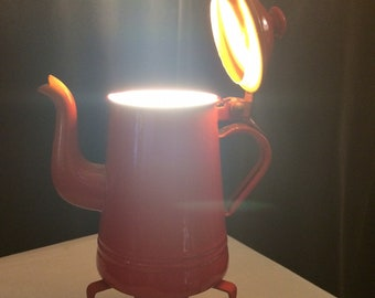 Vet 2 / lamp made from an old small orange-red, metal teapot enamelled