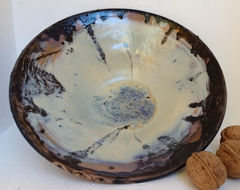 Deep enameled dish. Handmade pottery around