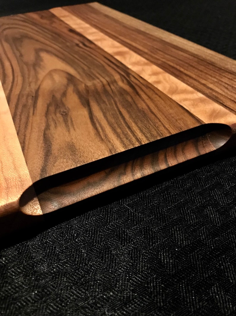 Gorgeous english walnut and quilted maple cutting board.