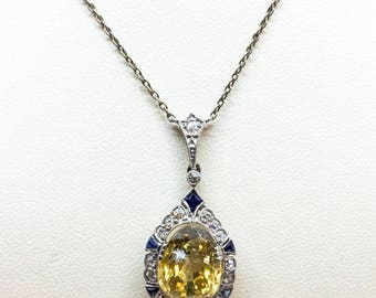 Pendant with necklace 14kt white gold with yellow sapphire