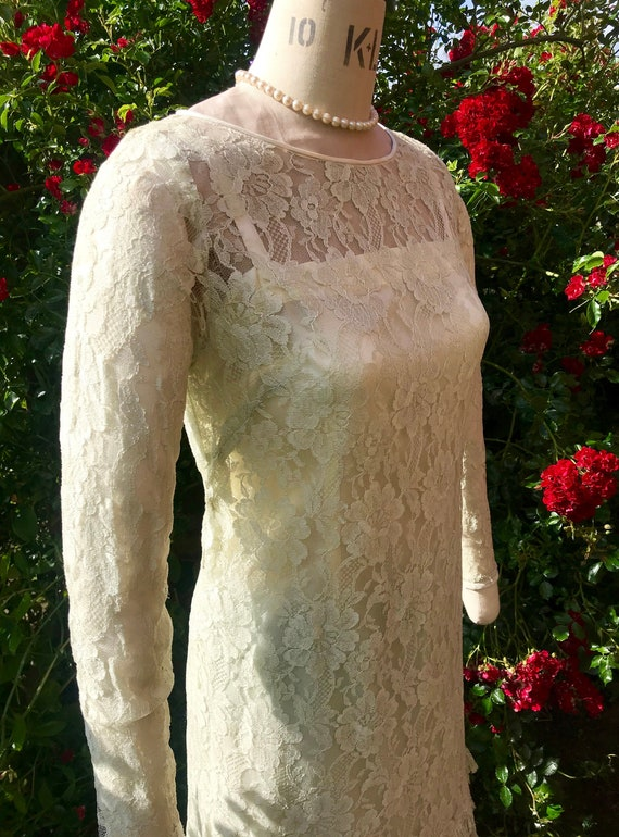 1960s lace dress with scalloped pleating at hem