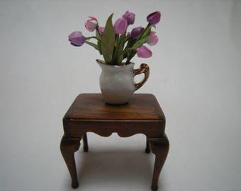 Miniature tulips in jug