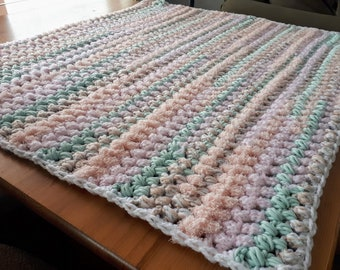 Soft coral multi-coloured crochet baby blanket