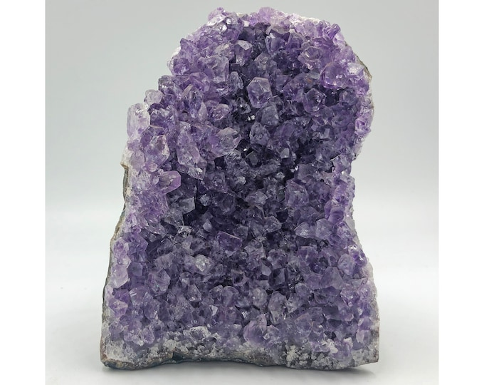 Cobble Creek: 1.7 LBS Self Standing Amethyst Cluster with Cut Base from Uruguay