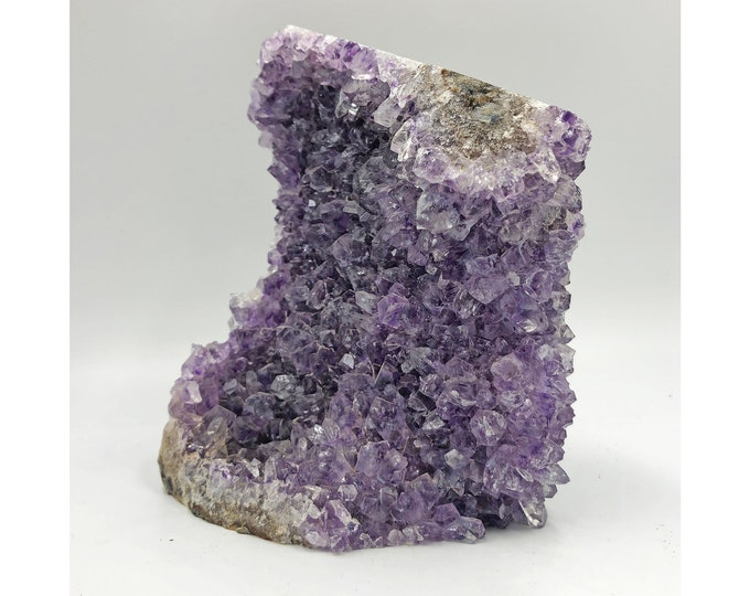 Cobble Creek: 2.12 LBS Self Standing Amethyst Cluster with Cut Base from Uruguay
