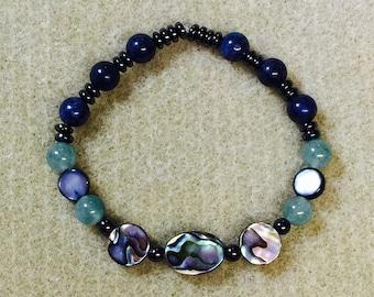 Healing, grounding stretch bracelet with abalone, hematite, aventurine and dumortierite.