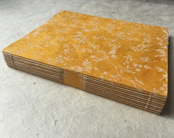 Handmade yellow paper book, Sewn with linen thread