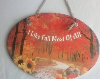 Who is ready for fall? A beautiful fall scene that has been sublimated on to a ceramic oval tile. Autumn leaves pumpkins & sunflowers.