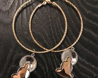 BIG BUDDHA - gold hoop earrings with charms on each.