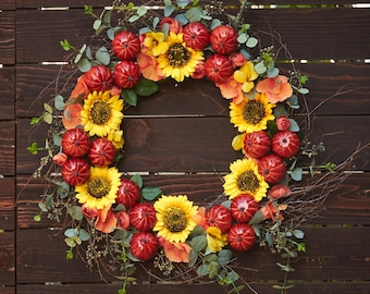 Fall wreath with sunflowers, pumpkins, and floral