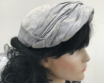 1950s style silver knotted fabric cap